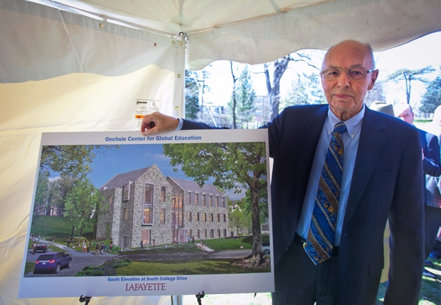 Walter Oechsle '57 Theta Xi with an artist's rendition of the Oechsle Center for Global Education